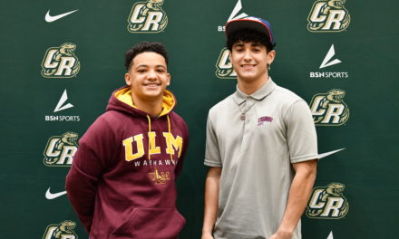Two Copperheads football players sign to play in college